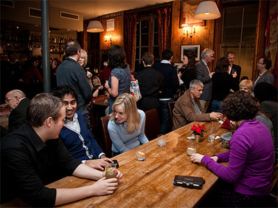 People eating and drinking at a gathering in the Club