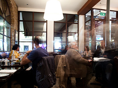 Diners at the Frontline Club restaurant