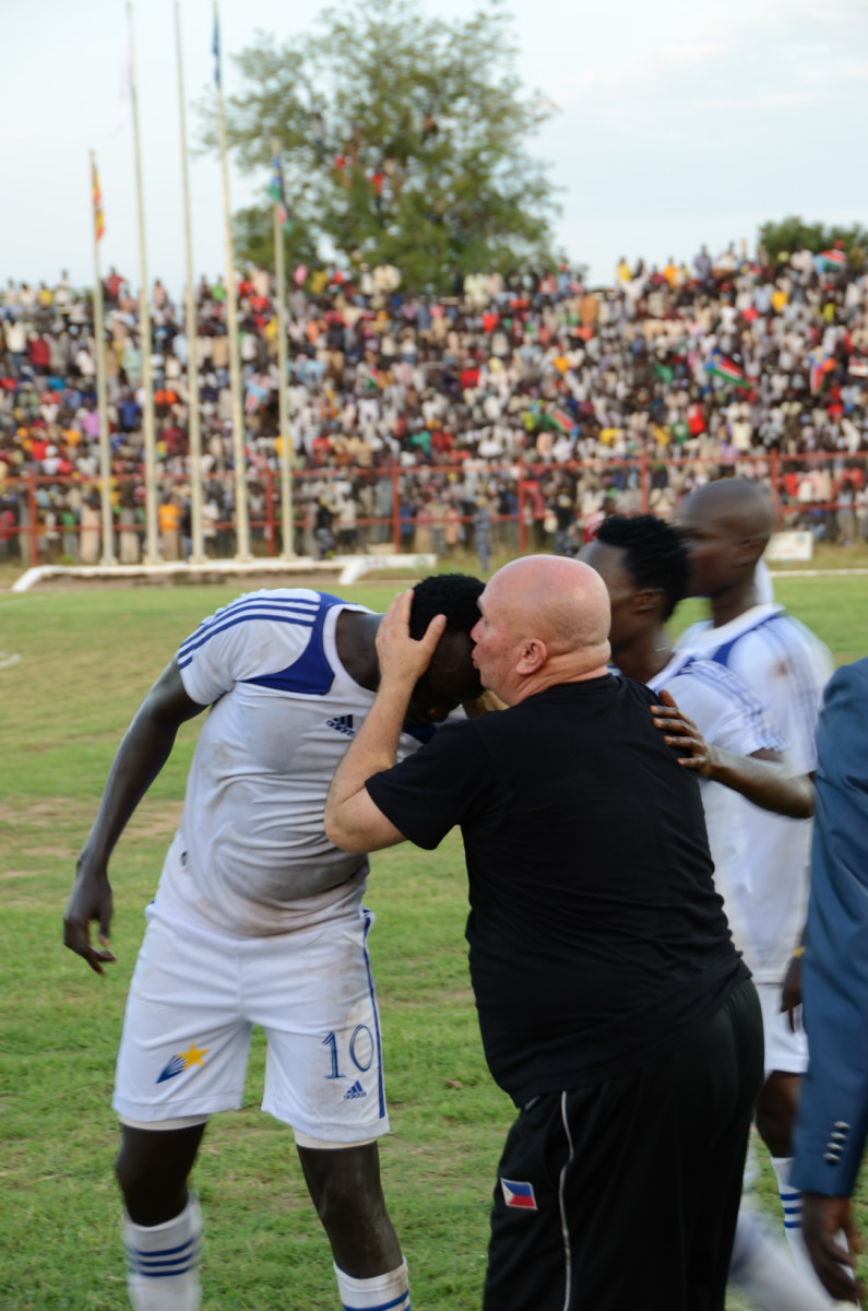 Coach Zoran congratulates the scorer of South Sudan's first ever goal in international football. Photo Richard Nield