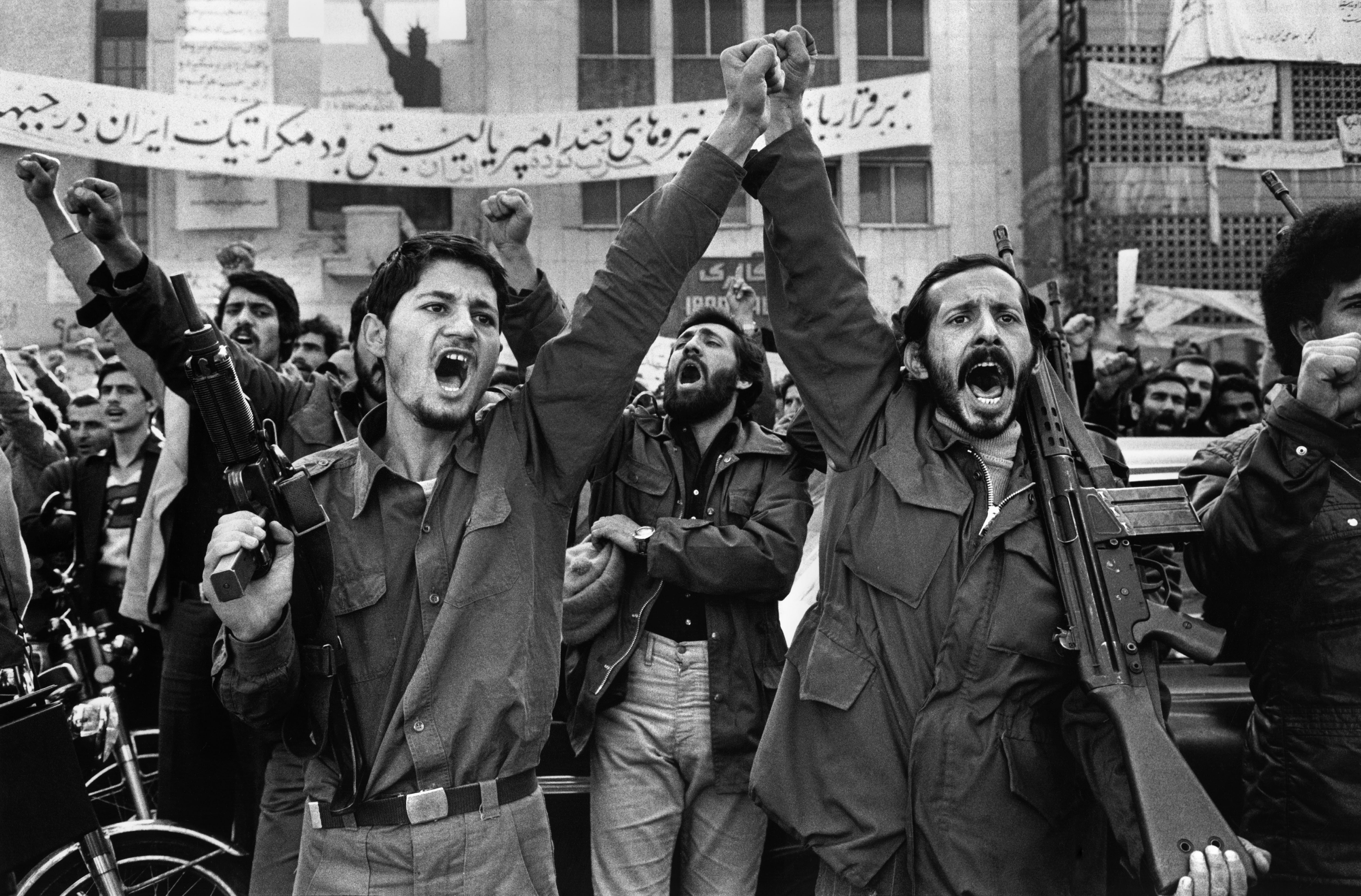 IRAN. Tehran. Armed militants outside the United States Embassy, where diplomats are held hostage since Nov. 4th, 1979. In the background is a banner with the American Statue of Liberty.
